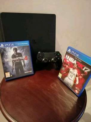 PS4 slim with 4 games and two pads