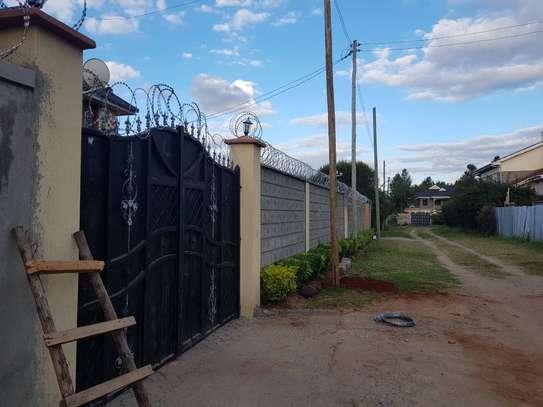 Razor wire installation in Kamulu image 2