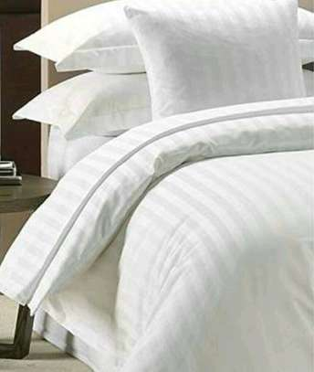PLAIN WHITE COTTON DUVETS WITH 1 BEDSHEET AND 2 PILLOW CASES image 1