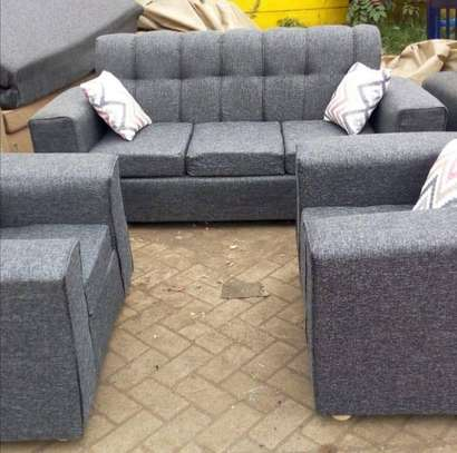 Grey back permanent  five seater sofa. image 1
