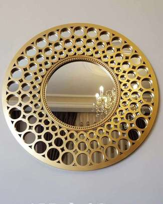 Golden circles round mirror .