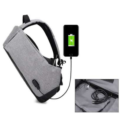 Anti-theft cross body backpack (single strap) with a USB charging port. image 5