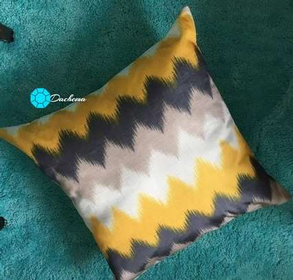 yellow patterned throw pillows image 1