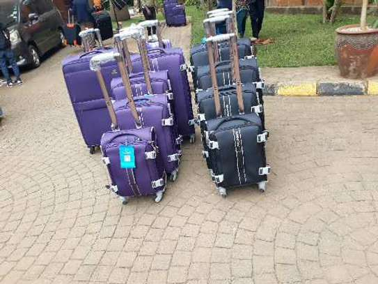Suitcases and laptops bags image 6