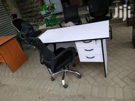 An office white desk plus an adjustable office chair in black image 1