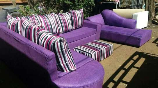 A 6 seater L seat and a sofabed image 1