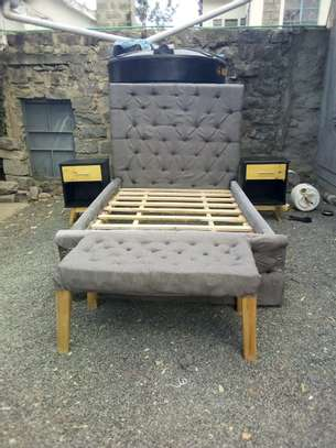 A Tufted 4 by 6 Hardwood bed image 3