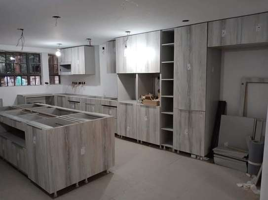 We design and install custom cabinets & wardrobes image 9