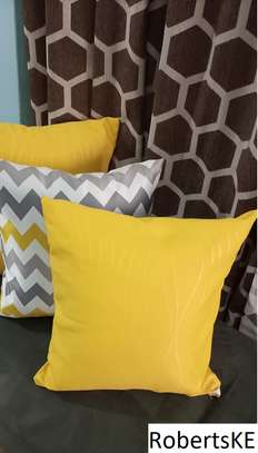 soft yellow throw pillow image 1