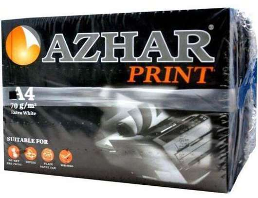 Azhar photocopying papers image 2