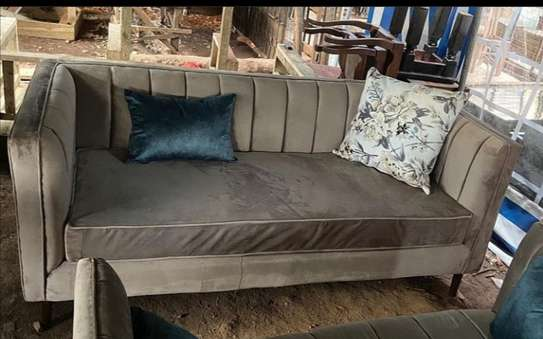 A brown  3 seater back permanent . image 1