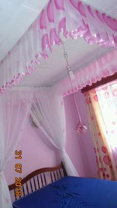 Mosquito Nets Sliding Like Curtains Fixed On The Ceiling