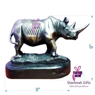 Rhino animal cast sculpture branded with a message on the base and packed in an elegant banana gift box with space for more gifts.@ Kes.8,500 only. image 1