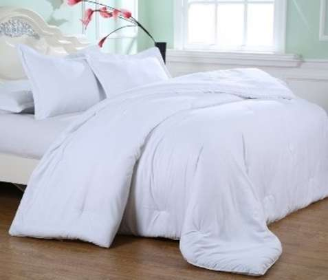 White Duvets with Bed Sheet and A Pair Of Pillow Case image 3