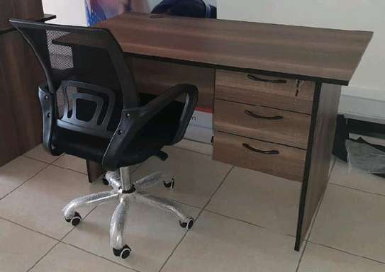 An office table with adjustable computer black office chair image 1