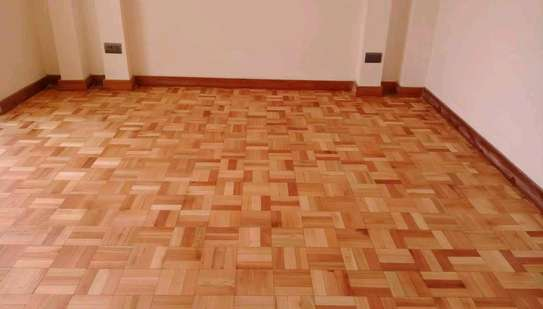 Wooden floor installation sanding and polishing services. image 6