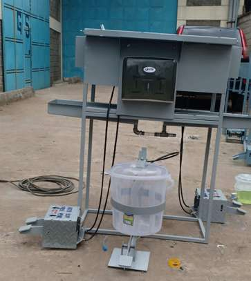 Hand washing station with foot pump