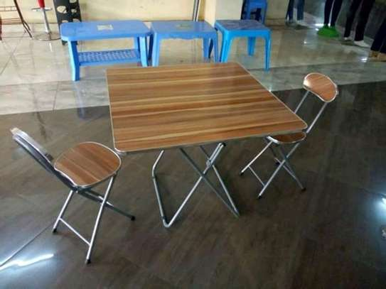 Foldable table with two chairs image 1