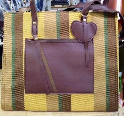 Purple and yellow handbags image 1