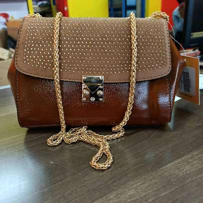 Golden brown authentic sling bags image 1
