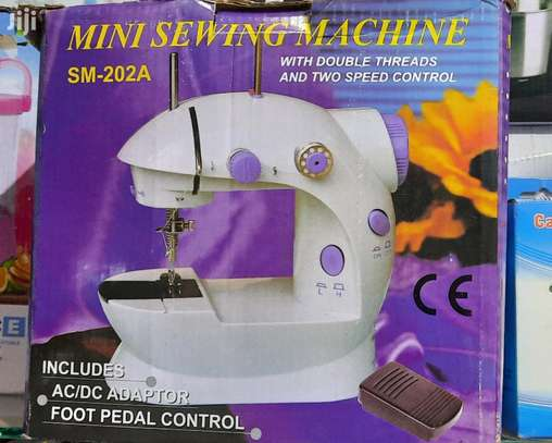 Unique Mini Electric Sewing Machines Can Also Use Batteries image 1