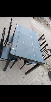 Guaranteed quality 4 seaters dining table plus chairs image 1