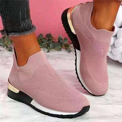 Pink slip on sneakers image 1