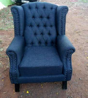 A blue Chesterfield wing chair image 1
