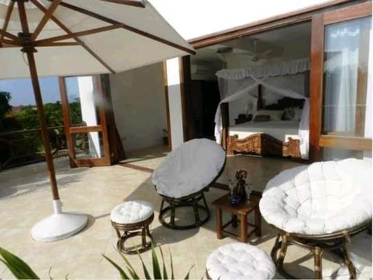 3 bedroom fully furnished own compound image 13