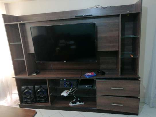Used Cabinet with TV mount board image 2
