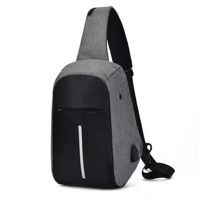 Anti-theft cross body backpack with a USB charging port.