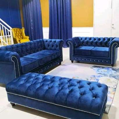A blue Chesterfield sofa image 1