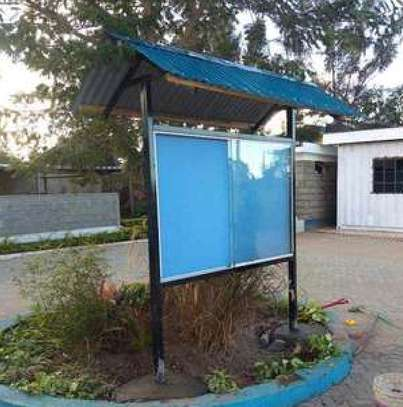 Glass sliding noticeboards with canopy
