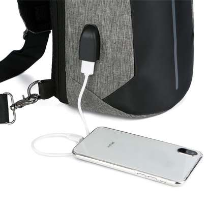 Anti-theft cross body backpack (single strap) with a USB charging port. image 4