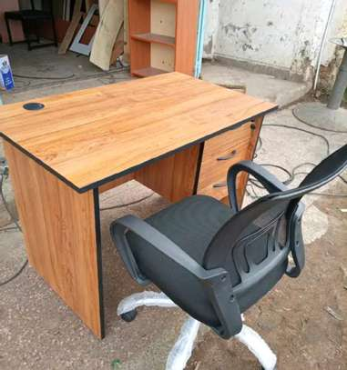 An office desk with an office chair of sturdy framework set on a 5 point aluminium base image 1