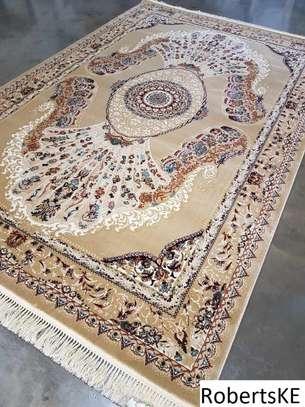 Beige patterned persian carpet