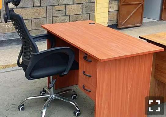 An office desk with a multifunctional headrest chair image 1
