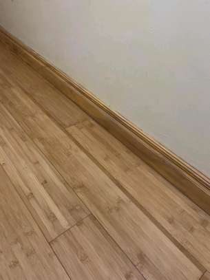 bamboo / laminated/ engineered wooden flooring.sale, installation, repairs and maintenance services image 2