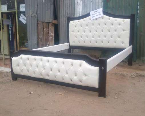 5 by 6 Black and White deep button bed
