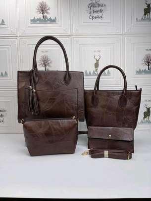 Dark brown designer handbags image 1