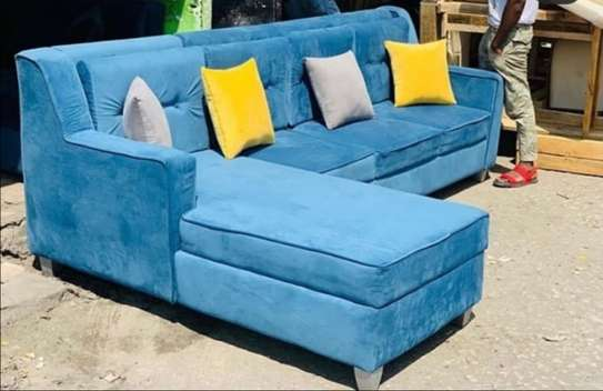 A plain blue 5 seater sofa l-shaped back pillowed image 1