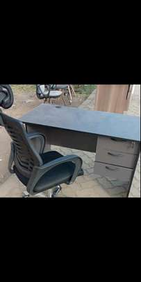 An office table plus flexible high back chair in black image 1