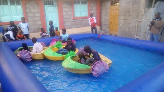 Electric boats,air balls and  water pools for hire image 3