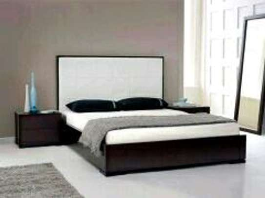 6 by 6 white bed with side drawers image 1