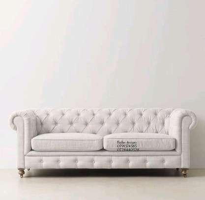 White three seater sofa image 1