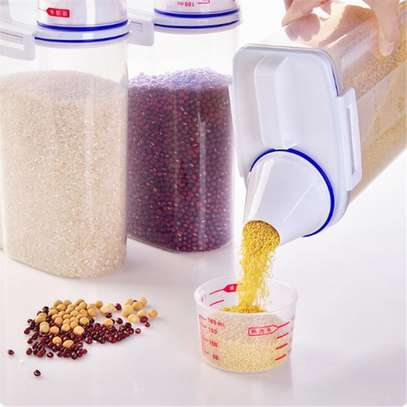 Kitchen Food Cereal Grain Bean Rice Hand With Measuring Cup image 1