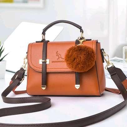 Orange designer handbags image 1