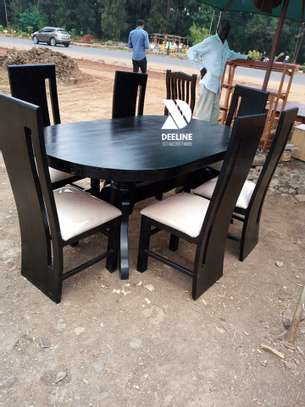 Black oval 6 seater dining table sets image 5
