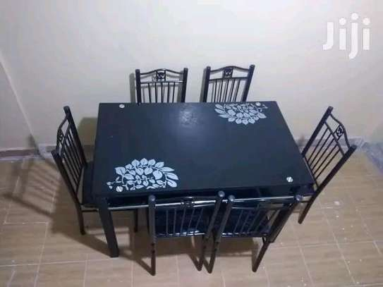 Dining room table with comfortable seating image 1