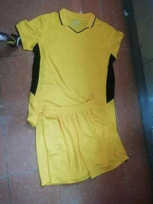 Netball uniforms and balls image 1